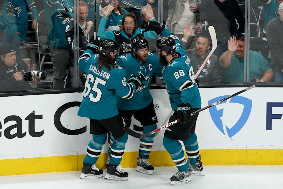 SAN JOSE, CALIFORNIA - MAY 11: Joe Pavelski #8 of the San Jose Sharks celebrates with his teammates Erik Karlsson #65 and Brent Burns #88 after scoring a goal on Jordan Binnington #50 of the St. Louis Blues during the first period in Game One of the Western Conference Finals during the 2019 NHL Stanley Cup Playoffs at SAP Center on May 11, 2019 in San Jose, California. (Photo by Thearon W. Henderson/Getty Images)