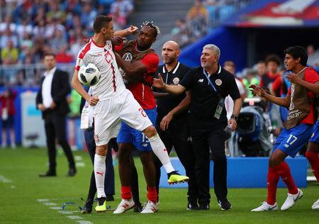 Soccer Football - World Cup - Group E - Costa Rica vs Serbia - Samara Arena, Samara, Russia - June 17, 2018 Serbia's Nemanja Matic clashes with Costa Rica's Kendall Waston after attempting to retrieve the ball from Costa Rica assistant manager Luis Marin REUTERS/Michael Dalder