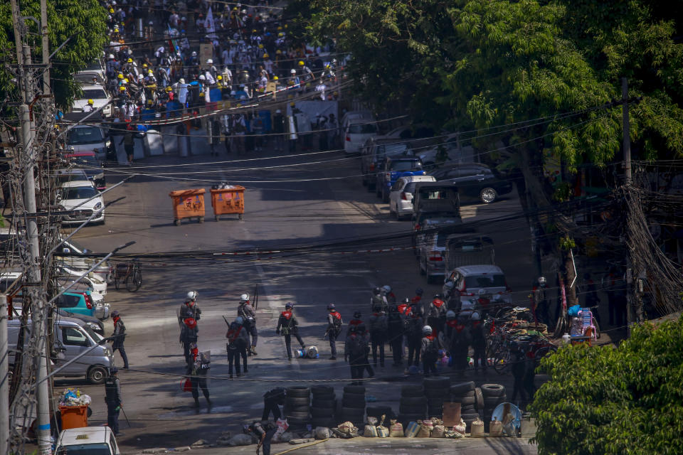 Anti-coup protesters standing behind barricades standoff with a group of police in Yangon, Myanmar, Thursday, March 4, 2021. Demonstrators in Myanmar protesting last month's military coup returned to the streets Thursday, undaunted by the killing of at least 38 people the previous day by security forces. (AP Photo)