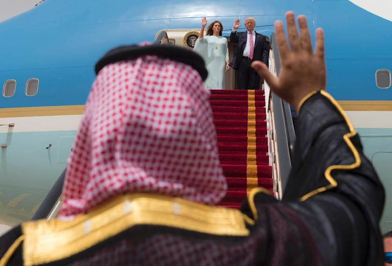 A handout picture provided by the Saudi Royal Palace on May 22, 2017, shows US President Donald Trump and First Lady Melania Trump waving as they board Air Force One before leaving Riyadh for Israel