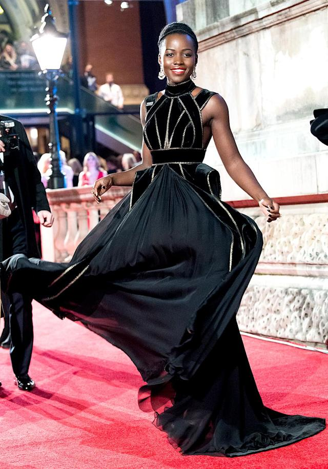 <p>Go with the flow! The <em>Black Panther</em> queen showed off her fluid moves in a gorgoeous black gown at the BAFTAs on Sunday night. (Photo: Samir Hussein/WireImage) </p>