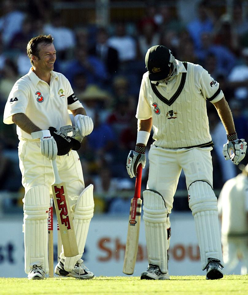 PERTH, AUSTRALIA - OCTOBER 9:  Steve Waugh of Australia smiles after team mate Matthew Hayden was struck by the ball during day one of the First Test between Australia and Zimbabwe played at the WACA on October 9, 2003 in Perth, Australia. (Photo by Hamish Blair/Getty Images)