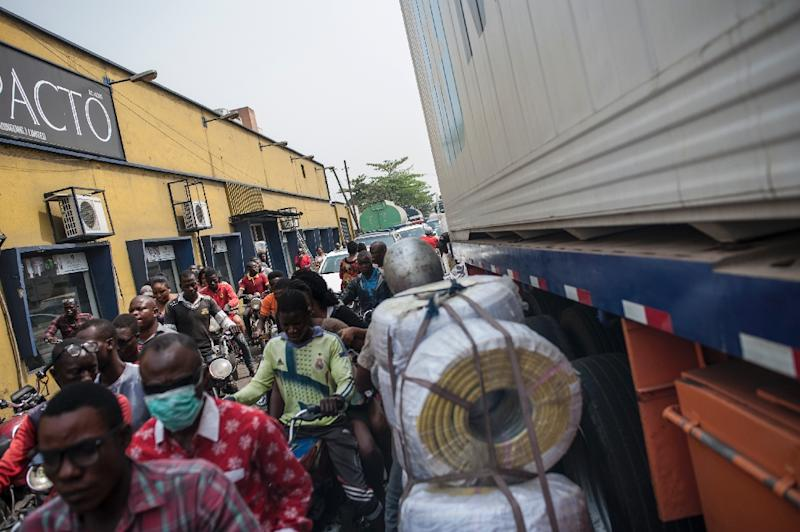 Commuters face a daily struggle to make their way through congested traffic in the port area of Lagos (AFP Photo/Stefan HEUNIS)