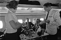 <p>Back in the '60s you could enjoy a white glove service meal IN THE AIR. That bar situation puts our present day food and beverage cart to shame. </p>