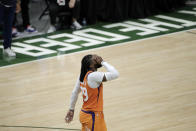 Phoenix Suns forward Jae Crowder (99) reacts at the end of Game 4 against the Milwaukee Bucks in basketball's NBA Finals Wednesday, July 14, 2021, in Milwaukee. (AP Photo/Aaron Gash)
