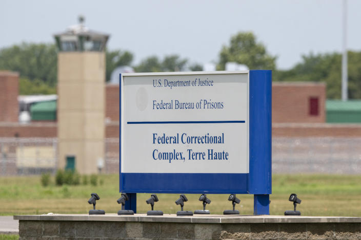 The entrance to the federal prison in Terre Haute, Ind., Wednesday, July 15, 2020. Wesley Ira Purkey, who raped and murdered a 16-year-old girl and killed an 80-year-old woman is scheduled to b e executed at 7:30 pm on Wednesday. (AP Photo/Michael Conroy)