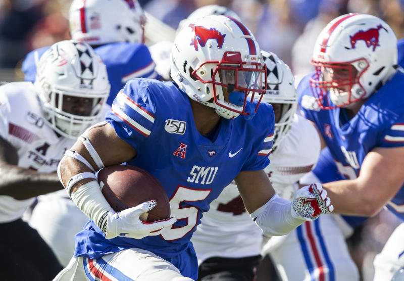 SMU running back Xavier Jones runs with the ball during the second quarter of an NCAA college football game against Temple in Dallas, Saturday, Oct. 19, 2019. (AP Photo/Sam Hodde)