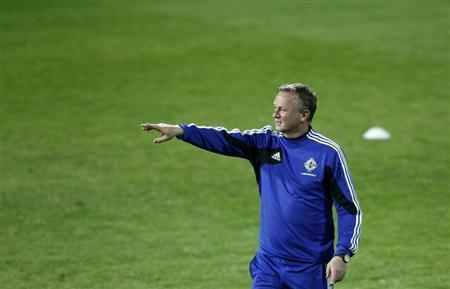 Northern Ireland coach Michael O'Neill attends a training session ahead of their 2014 World Cup qualifying soccer match against Azerbaijan in Baku, October 10, 2013. REUTERS/David Mdzinarishvili