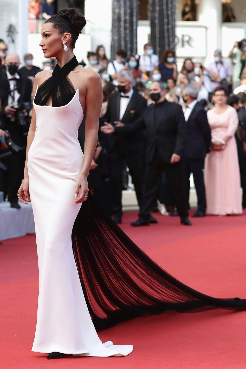 <p>Bella Hadid cut a striking figure in her halterneck gown, which featured a long sheer train. </p>