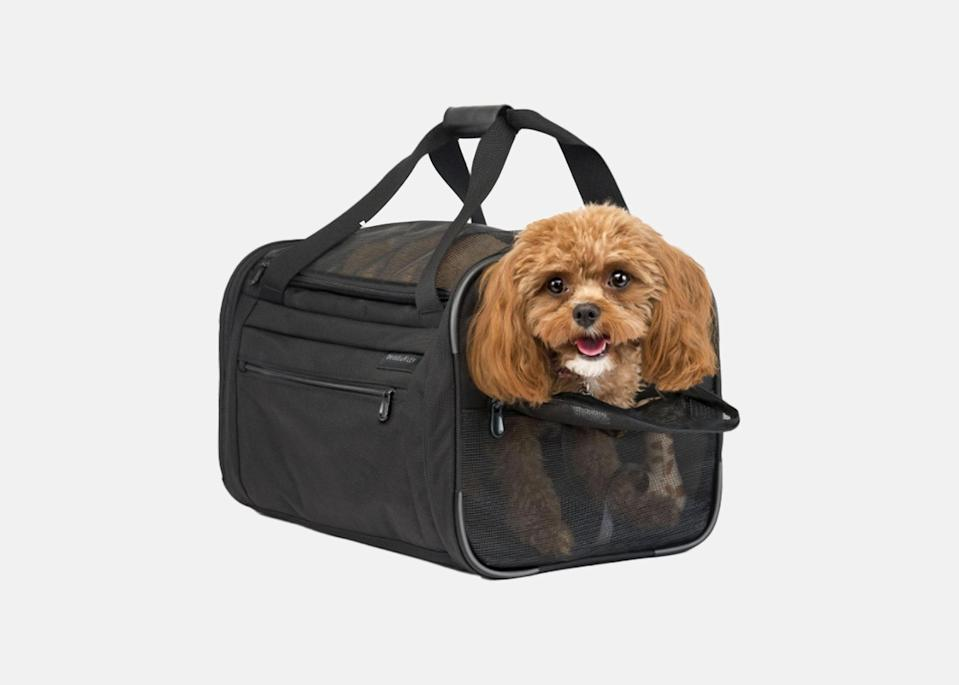 """<p>If you're looking for a pet carrier that is just as sleek and durable as your favorite <a href=""""https://www.cntraveler.com/galleries/2012-07-25/best-travel-luggage-suitcase-samsonite-rimowa?mbid=synd_yahoo_rss"""" rel=""""nofollow noopener"""" target=""""_blank"""" data-ylk=""""slk:hard-shell carry on"""" class=""""link rapid-noclick-resp"""">hard-shell carry on</a>, look no further than this luxe Briggs & Riley tote. The bag provides a safe, comfortable seat for your animal during take off and touch down, and also provides extra storage for paperwork, treats, food, and other essentials with expandable front and side pockets. Plus, if you're looking to match your pet, you can pick up a matching <a href=""""https://www.cntraveler.com/gallery/the-best-lightweight-luggage?mbid=synd_yahoo_rss"""" rel=""""nofollow noopener"""" target=""""_blank"""" data-ylk=""""slk:carry-on"""" class=""""link rapid-noclick-resp"""">carry-on</a> for yourself so both you and your fur baby can travel in style.</p> <p><strong>Buy now:</strong> <a href=""""https://fave.co/3fTzzI0"""" rel=""""nofollow noopener"""" target=""""_blank"""" data-ylk=""""slk:$250, briggs-riley.com"""" class=""""link rapid-noclick-resp"""">$250, briggs-riley.com</a></p>"""