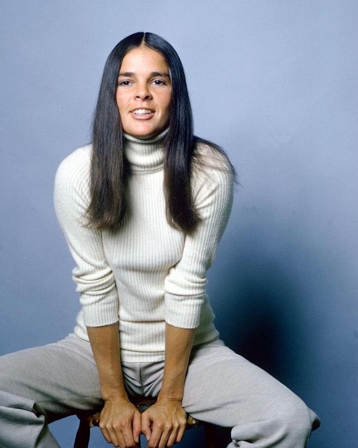 """<p>After 1970's <em><a href=""""https://www.amazon.com/Love-Story-Ali-MacGraw/dp/B000059TEQ?tag=syn-yahoo-20&ascsubtag=%5Bartid%7C10055.g.22675797%5Bsrc%7Cyahoo-us"""" rel=""""nofollow noopener"""" target=""""_blank"""" data-ylk=""""slk:Love Story"""" class=""""link rapid-noclick-resp"""">Love Story</a></em> starring Ali MacGraw and Ryan O'Neal became the hit of the year, women started rocking <a href=""""https://www.goodhousekeeping.com/beauty/hair/a36303/change-hair-parts/"""" rel=""""nofollow noopener"""" target=""""_blank"""" data-ylk=""""slk:center-parted straight styles"""" class=""""link rapid-noclick-resp"""">center-parted straight styles</a>.</p>"""