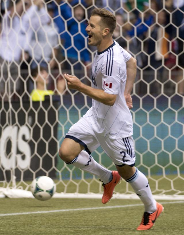 Vancouver Whitecaps FC's Jordan Harvey celebrates his goal against Chivas USA during the first half of an MLS soccer game in Vancouver, British Columbia, Wednesday, June, 19, 2013. (AP Photo/The Canadian Press, Jonathan Hayward)