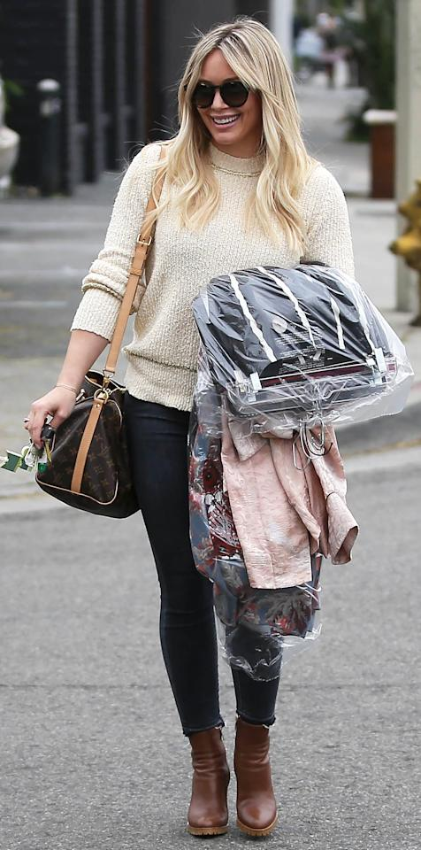 <p>The <em>Younger</em> star was spotted running errands in Los Angeles looking super stylish in a cozy ivory knit and dark denim skinnies. She paired the pieces with brown leather booties, a matching monogram Louis Vuitton satchel, and oversize sunglasses.</p>