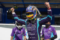 Romain Grosjean, of Switzerland, celebrates after winning the pole during qualifications for the IndyCar auto race at Indianapolis Motor Speedway in Indianapolis, Friday, May 14, 2021. (AP Photo/Michael Conroy)