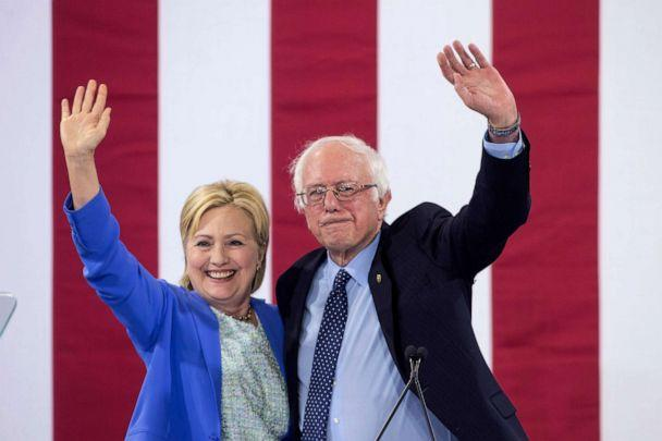 PHOTO: Presidential candidate Hillary Clinton and Senator Bernie Sanders wave from the stage during a campaign event in Portsmouth, N.H., July 12, 2016, in which Sanders endorsed Clinton. (Boston Globe via Getty Images, FILE)
