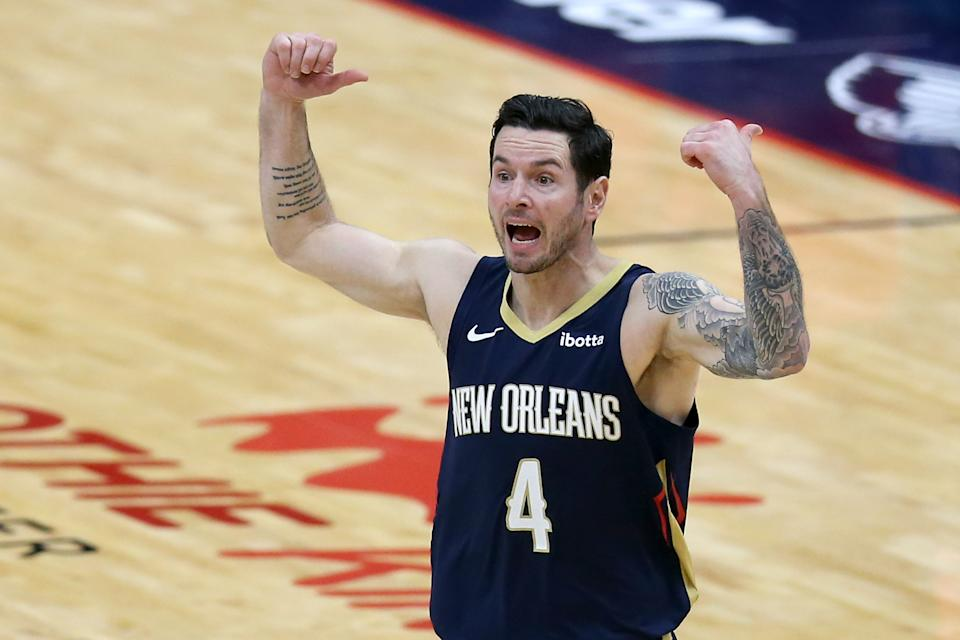 JJ Redick #4 of the New Orleans Pelicans reacts during the third quarter of an NBA game against the Phoenix Suns at Smoothie King Center.
