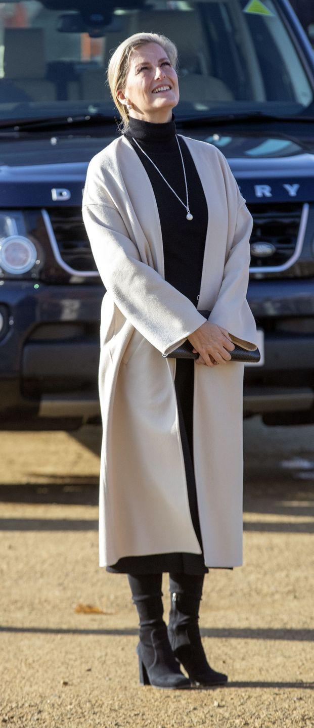 <p>Sophie, Countess of Wessex looked casual chic in a cream coat, black turtleneck, skirt, and boots for a visit to the newly restored Royal Victoria Chapel in Netley. </p>