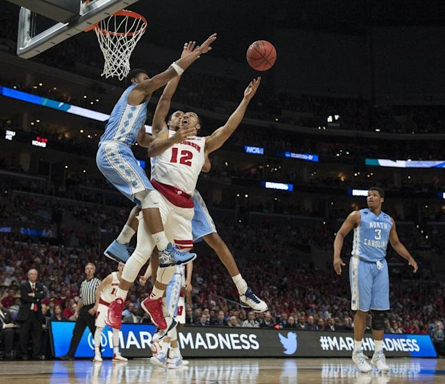 Wisconsin Badgers guard Traevon Jackson drives the lane against North Carolina Tar Heels guard Joel Berry II during the second half during NCAA West Region semifinals at Staples Center in Los Angeles on Thursday March 26, 2015. Wisconsin Badgers wins with the score of 79 to 72. (AP Photo/The Orange County Register, Ed Crisostomo)