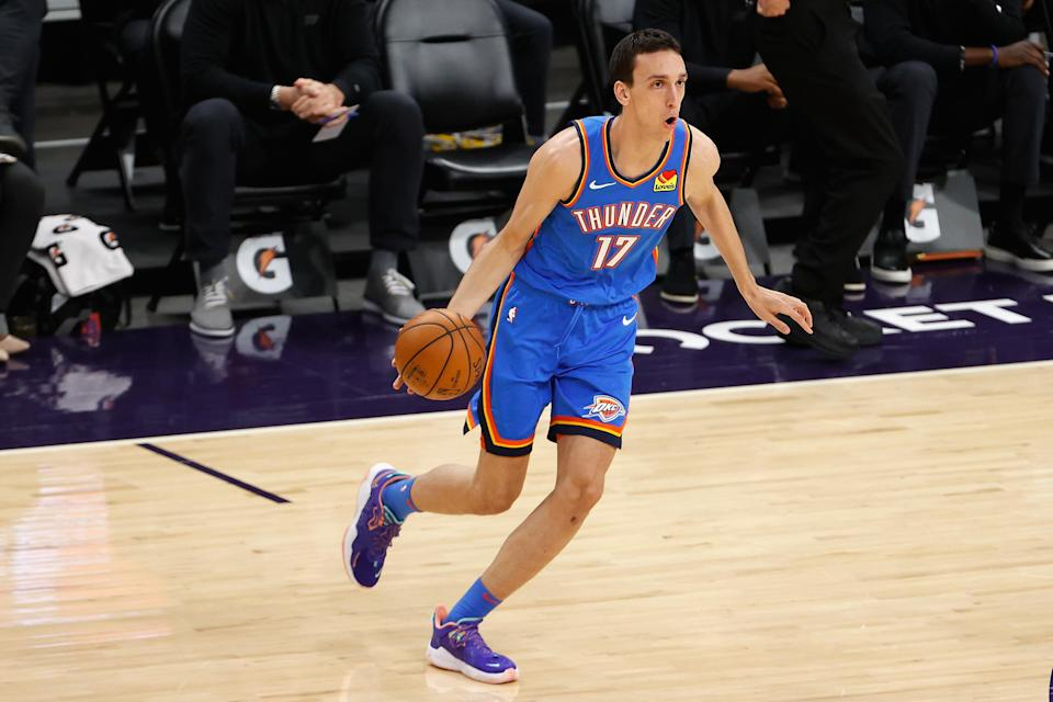 PHOENIX, ARIZONA - APRIL 02: Aleksej Pokusevski #17 of the Oklahoma City Thunder handles the ball against the Phoenix Suns during the NBA game at Phoenix Suns Arena on April 02, 2021 in Phoenix, Arizona. The Suns defeated the Thunder 140-103. NOTE TO USER: User expressly acknowledges and agrees that, by downloading and or using this photograph, User is consenting to the terms and conditions of the Getty Images License Agreement.
