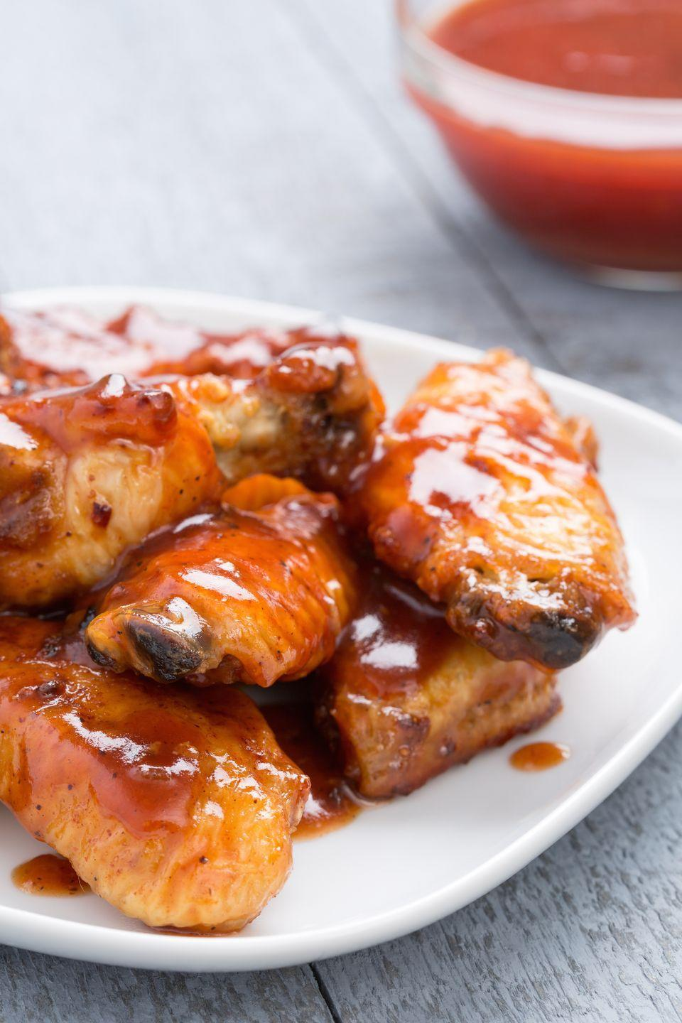 """<p>When you want to take a break from buffalo, reach for barbecue sauce—and bourbon for good measure.</p><p>Get the recipe from <a href=""""http://rams.delish.com/cooking/recipe-ideas/recipes/a44369/slow-cooker-barbecue-bourbon-chicken-wings-recipe/"""" rel=""""nofollow noopener"""" target=""""_blank"""" data-ylk=""""slk:Delish"""" class=""""link rapid-noclick-resp"""">Delish</a>. </p>"""
