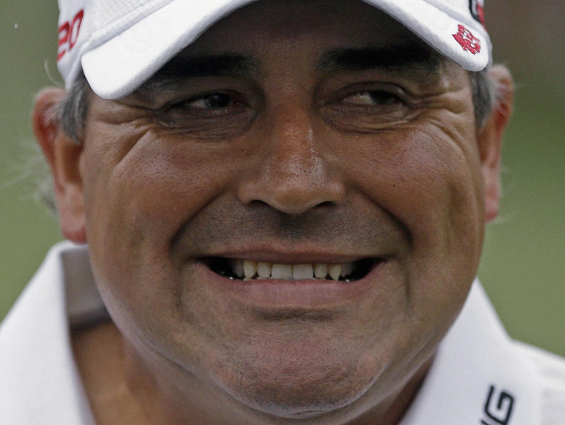 Angel Cabrera, of Argentina, grimaces after sinking a birdie putt on the second green during the fourth round of the Masters golf tournament Sunday, April 14, 2013, in Augusta, Ga. (AP Photo/David Goldman)