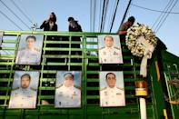 Protestors in Thailand put portraits of members of the government up on a truck and held a symbolic no-confidence vote outside the parliament