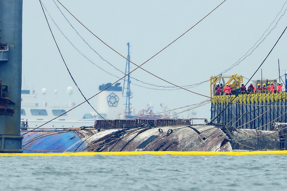 <p>The ferry Sewol is raised from the sea off Jindo Island, South Korea. (Picture: Rex) </p>