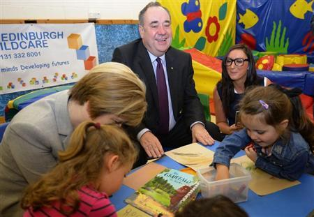 Scotland's First Minister Alex Salmond and Deputy First Minister Nicola Sturgeon speak to pupils during a visit to North Edinburgh Childcare, Training and Creche Services, before a debate in the Scottish Parliament on 'Scotland's future,' in Edinburgh