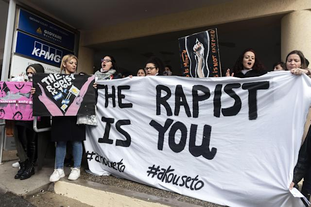 Women's rights activists protest at the court on Monday in support of the British 19-year-old. (Iakovos Hatzistavrou/AFP via Getty Images)
