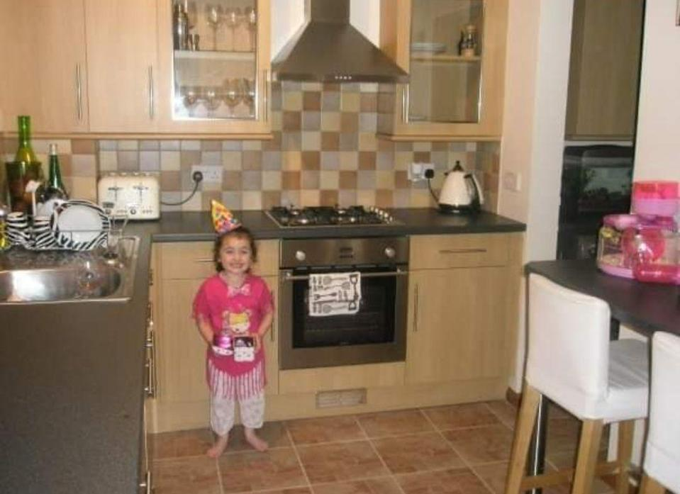 """<p>Michelle put her furlough time to good use by painting her <a href=""""https://www.housebeautiful.com/uk/decorate/kitchen/g35138029/kitchen-cupboard-paint/"""" rel=""""nofollow noopener"""" target=""""_blank"""" data-ylk=""""slk:kitchen cupboards"""" class=""""link rapid-noclick-resp"""">kitchen cupboards</a> and walls, adding new handles on the drawers, and replacing the cooker hood and flooring. Take a look at her transformation below...<br></p>"""