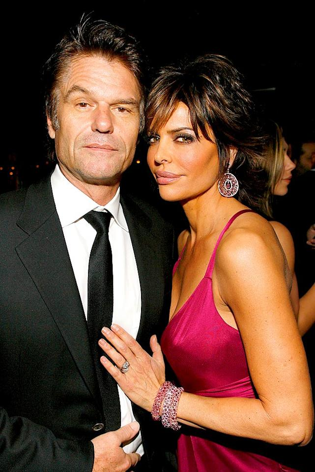 "Harry Hamlin and his wife of 11 years, Lisa Rinna, are undoubtedly the best-dressed couple of the evening. Too bad we can barely see past the former ""Melrose Place"" vixen's freshly-plumped lips! Mark Von Holden/<a href=""http://www.wireimage.com"" target=""new"">WireImage.com</a> - January 31, 2008"