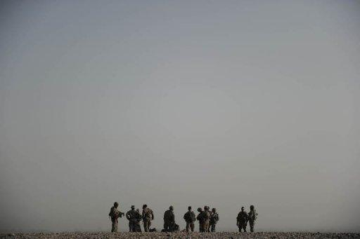 Soldiers prepare for a morning patrol in Arghandab Valley in 2010. The White House and NATO on Wednesday condemned grisly photographs showing US soldiers with the mangled remains of suspected Taliban suicide bombers in Afghanistan