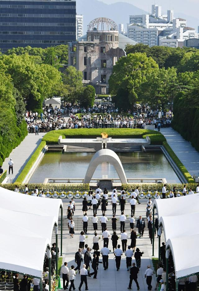 "<p>People attend a ceremony to mark the 72nd anniversary of the world's first atomic bombing that killed 140,000 people at the Peace Memorial Park in Hiroshima, western Japan, Sunday, Aug. 6, 2017. Hiroshima's appeal of ""never again"" on the 72nd anniversary has acquired renewed urgency as North Korea moves ever closer to acquiring nuclear weapons. (Photo: Ryosuke Ozawa/Kyodo News via AP) </p>"
