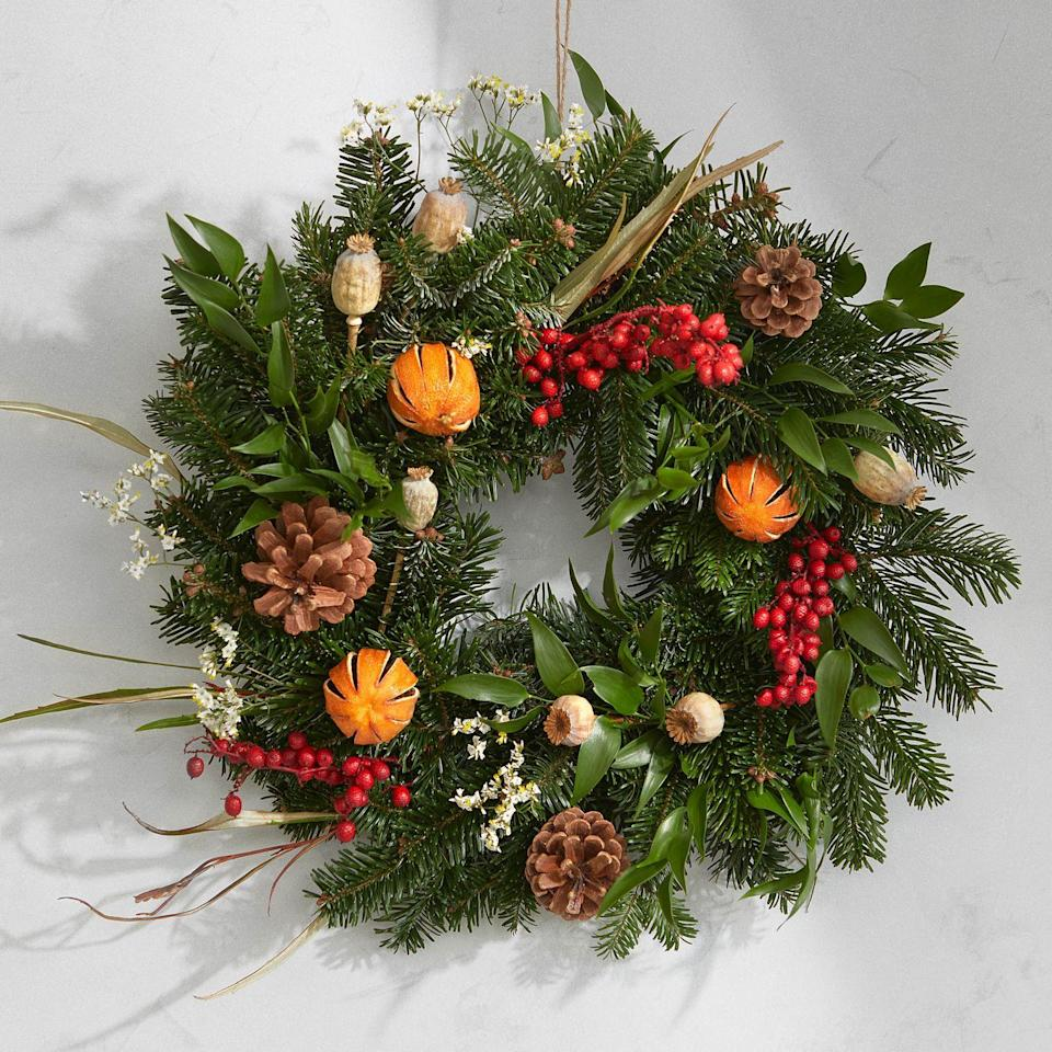 "<p>With all social events on hold for the time being, it's time to find new ways to boost your festive spirit. This letterbox-ready kit contains everything you need to craft your own luxury wreath, from luscious fir branches to dried oranges and berries. Get creative. £45, <a href=""https://www.bloomandwild.com/send-flowers/tagonly/christmas"" rel=""nofollow noopener"" target=""_blank"" data-ylk=""slk:bloomandwild.com"" class=""link rapid-noclick-resp"">bloomandwild.com </a></p>"