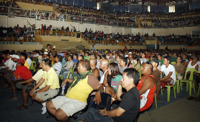 People watch the live telecast of the WBO welterweight title bout between Philippine boxing icon Manny Pacquiao and Timothy Bradley of the US at a stadium in General Santos City, in southern island of Mindanao on June 10, 2012.  The Philippines was silenced June 10 after boxing superstar Manny Pacquiao was stunned by American challenger Timothy Bradley, losing his first bout in seven years.    AFP PHOTO/Paul BernaldezPAUL BERNANDEZ/AFP/GettyImages