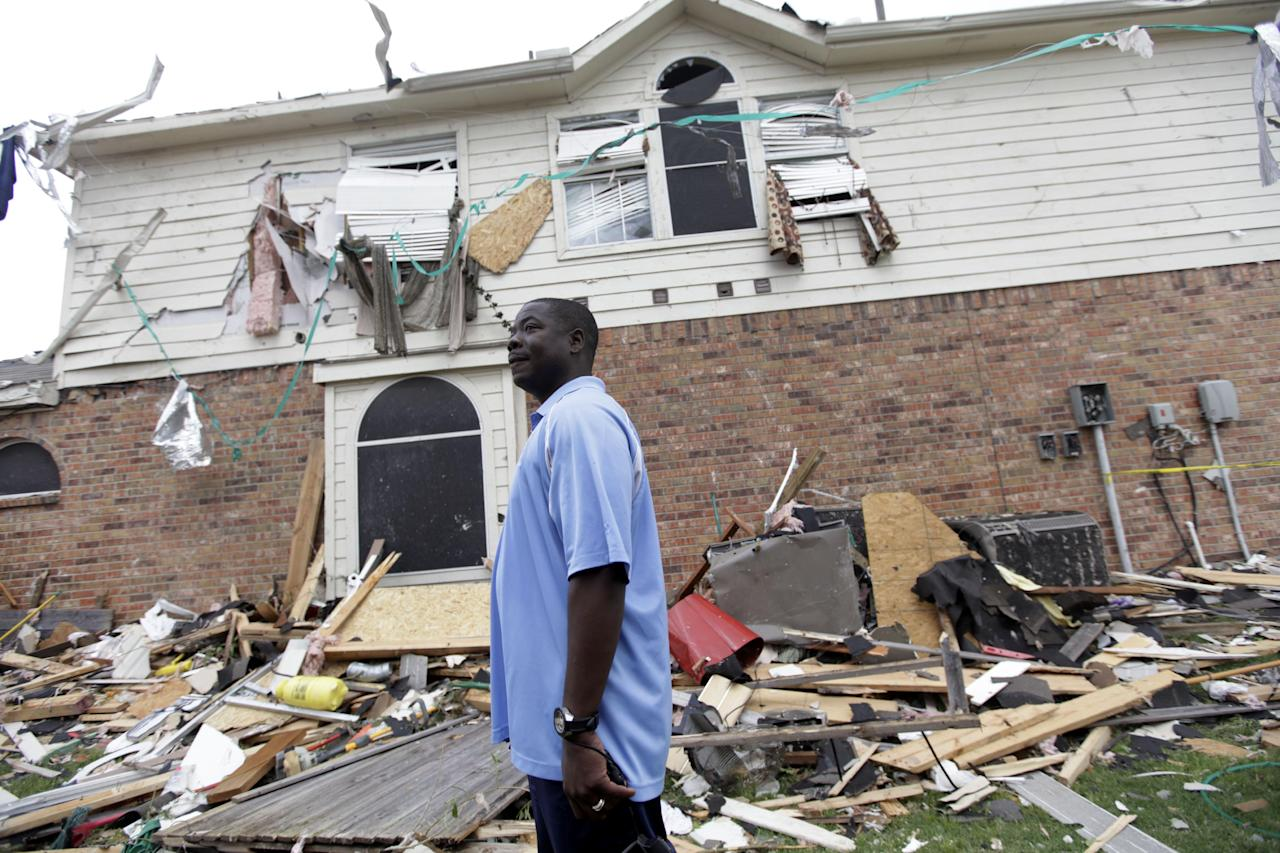 "Charles Paige stands amongst tornado debris as he surveys the damage to his home Wednesday, April 4, 2012, in Forney, Texas. The mayor of Forney, Texas, says it's ""a real blessing"" that nobody was killed in the community by the tornadoes that ripped through parts of the Dallas area yesterday (AP Photo/Tony Gutierrez)"