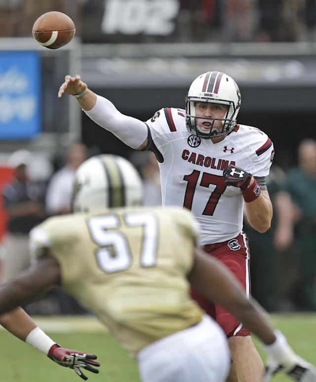 South Carolina quarterback Dylan Thompson (17) throws a pass over Central Florida linebacker Troy Gray (57) during the first half of an NCAA college football game in Orlando, Fla., Saturday, Sept. 28, 2013.(AP Photo/John Raoux)
