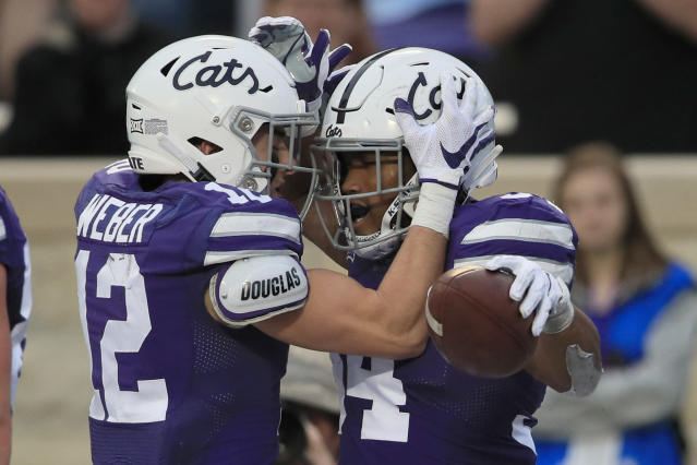 Kansas State wide receiver Landry Weber (12) congratulates running back James Gilbert (34) on a touchdown during the second half of an NCAA college football game against West Virginia in Manhattan, Kan., Saturday, Nov. 16, 2019. (AP Photo/Orlin Wagner)