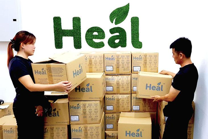 The team at the Heal Nutrition headquarters packing products for delivery