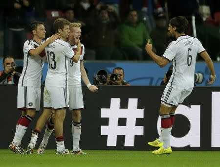 Germany's Andre Schuerrle (2nd R) celebrates his goal against Algeria with team mates during extra time in their 2014 World Cup round of 16 game at the Beira Rio stadium in Porto Alegre June 30, 2014. REUTERS/Henry Romero