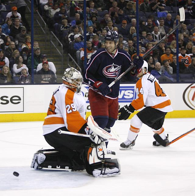 Columbus Blue Jackets' RJ Umberger (18) watches the puck after scoring against Philadelphia Flyers goalie Ray Emery (29) during the second period of an NHL hockey game on Saturday, Dec. 21, 2013, in Columbus, Ohio. (AP Photo/Mike Munden)