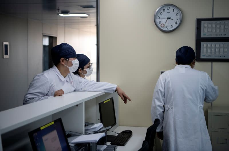 The nurses talk inside finished but still unused building A2 of the Shanghai Public Clinical Center, following the outbreak of the new coronavirus, in Shanghai
