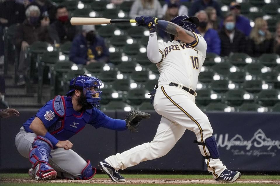 Milwaukee Brewers' Omar Narvaez hits a run-scoring sacrifice fly during the first inning of a baseball game against the Chicago Cubs Wednesday, April 14, 2021, in Milwaukee. (AP Photo/Morry Gash)