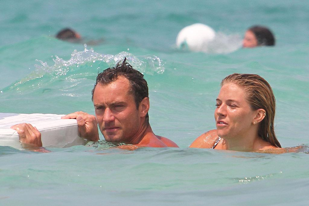 """Elsewhere in Italy, on-again couple Jude Law and Sienna Miller splashed around while on holiday with the British bad boy's children. Ciao Pix/<a href=""""http://www.infdaily.com"""" target=""""new"""">INFDaily.com</a> - July 20, 2010"""