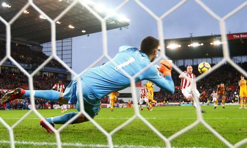 Charlie Adam squanders late penalty in Stoke's dramatic draw with Brighton