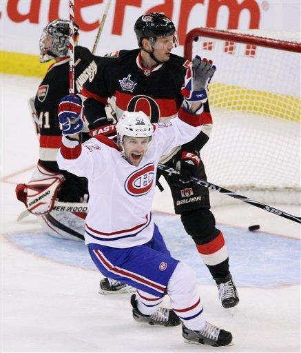 Montreal Canadiens Mathieu Darche( 52) celebrates a goal as Ottawa Senators goalie Craig Anderson and Sergei Gonchar (55) look on, during first period NHL hockey action in Ottawa Tuesday Dec. 27, 2011. (AP Photo/The Canadian Press, Fred Chartrand)