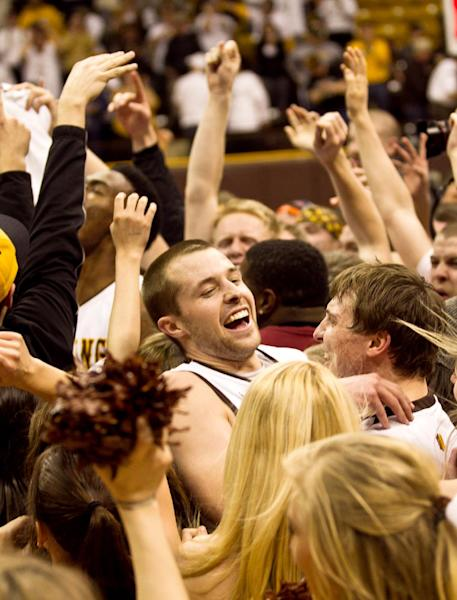 University of Wyoming guard Nathan Sobey (20) celebrates with fans after defeating San Diego State, 68-62 in a mens NCAA basketball game Tuesday, Feb. 11, 2014, at the Arena-Auditorium in Laramie, Wyo.(AP Photo/Jeremy Martin)