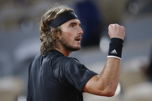 The Latest: Tsitsipas wins 4th set against Djokovic 6-4