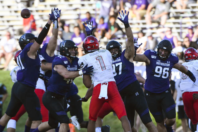 UNLV quarterback Armani Rogers (1) is defended by Northwestern defensive lineman Samdup Miller, left, linebacker Paddy Fisher (42), defensive lineman Joe Gaziano (97) and defensive end Trevor Kent (96) during the second half of an NCAA college football game, Saturday, Sept. 14, 2019, in Evanston, Ill. (AP Photo/Matt Marton)