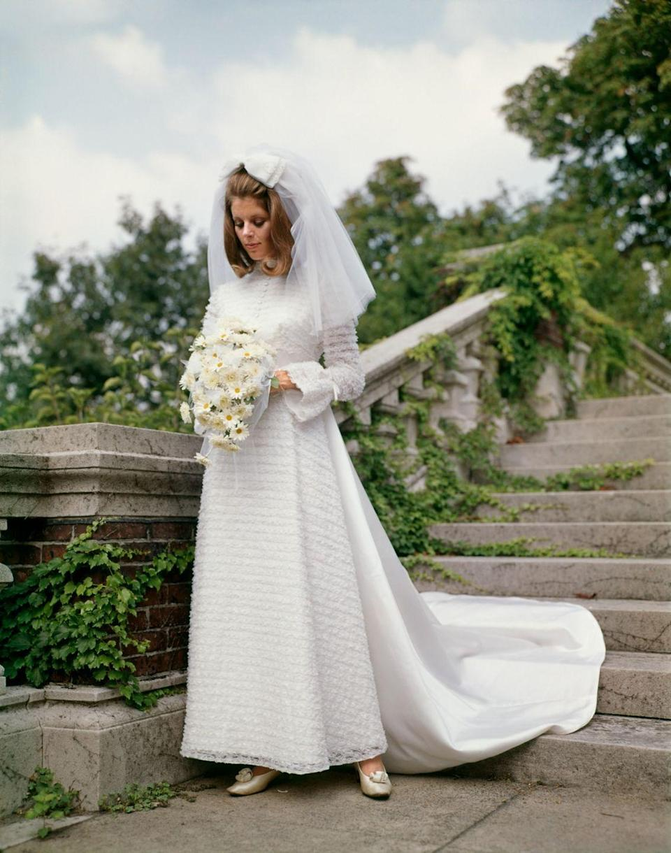 <p>In the1970s, wedding trends were all over the map, with brides wearing everything from traditional gowns to pantsuits. This was the decade when men started sporting colored tuxedos, too. </p>